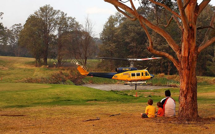golf course bushfire helicopter