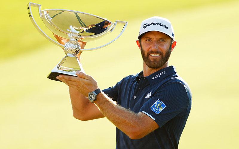 Dustin Johnson with FedEx trophy
