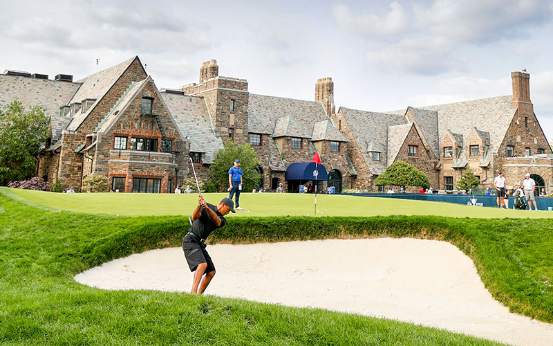 Tiger Woods plays a bunker shot in the practice area during the practice round at the 2020 U.S. Open at Winged Foot Golf Club (West Course) in Mamaroneck, N.Y. on Monday. (USGA/Chris Keane)