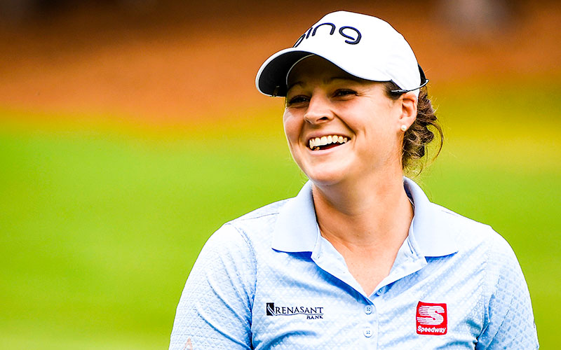 Ally McDonald smiles as she walks up the 17th fairway during the 2020 LPGA Drive On Championship