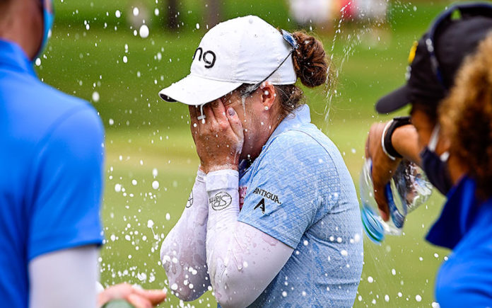 Ally McDonald is doused with champagne on the 18th green immediately after winning the 2020 LPGA Drive On Championship