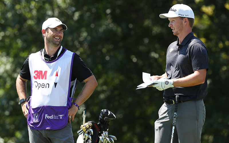 The Caddy Life: Jake Kneen of the United States talks with his caddie, Nick Pumford