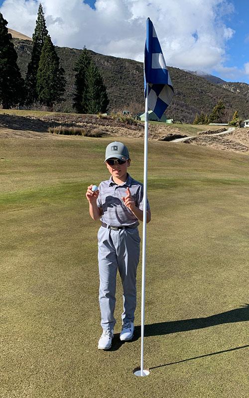 Josh Harris with his hole in one ball and pin. (Supplied)