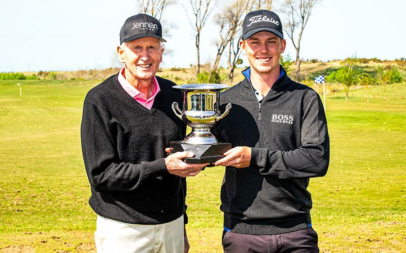 Sir Bob Charles present winner Daniel Hillier with the trophy after winning the DVS Pegasus Open. (NZ Golf)