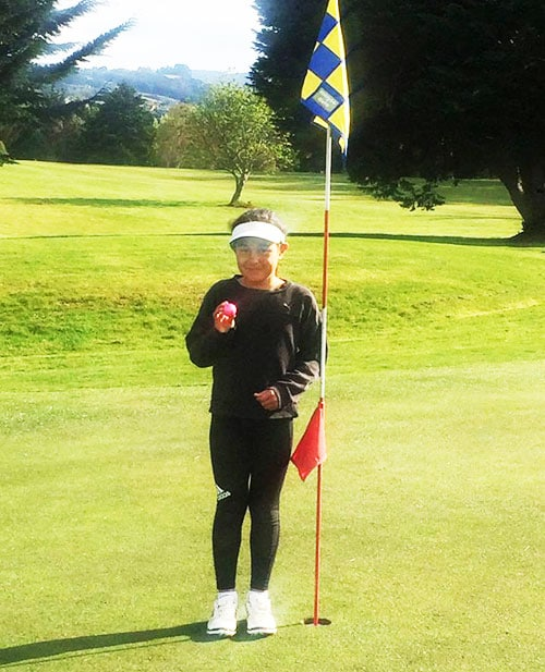 Junior star Maia Koni, 8 years old, after scoring a hole in one on the par three 5th hole at Island Park Saturday club day recently.