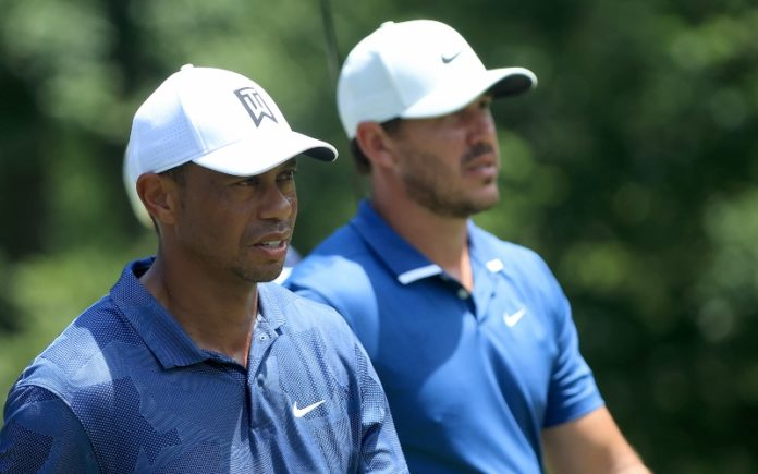 Tiger Woods of the United States and Brooks Koepka of the United States walk from the ninth tee during the second round of The Memorial Tournament on July 17, 2020 at Muirfield Village Golf Club in Dublin, Ohio. (Photo by Sam Greenwood/Getty Images)