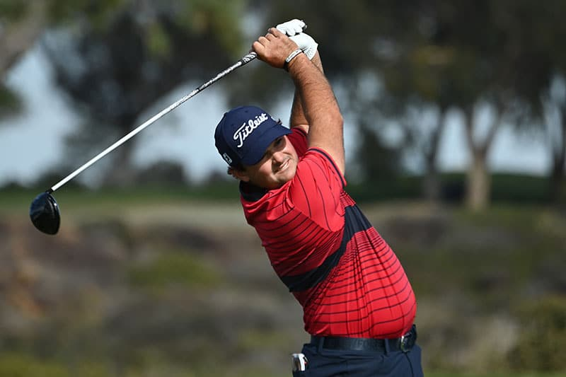 Patrick Reed hits his tee shot on the 5th hole during the final round of the Farmers Insurance Open at Torrey Pines South on January 31, 2021 in San Diego, California. (Photo by Donald Miralle/Getty Images)