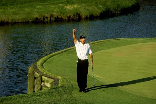 """Tiger Woods celebrates making his """"Better than most"""" putt at the 17th hole during the third round of The PLAYERS Championship at the TPC Stadium course on March 24, 2001 in Ponte Vedra Beach, Florida. (Photo by Chris Condon/PGA TOUR via Getty Images)"""