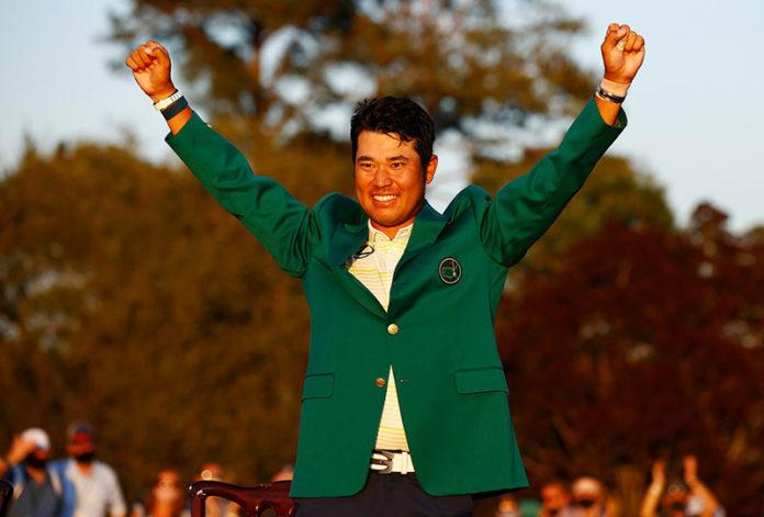 Hideki Matsuyama celebrates with the green jacket after winning The Masters