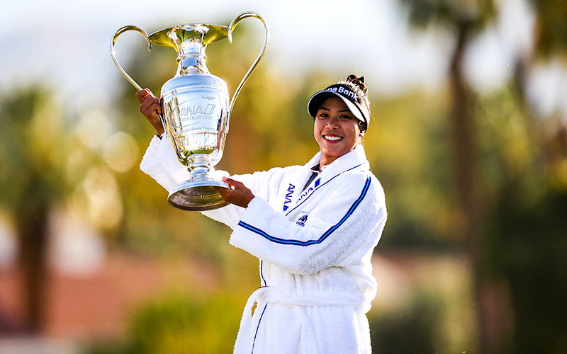 Patty Tavatanakit of Thailand celebrates with the trophy after winning the final round of the ANA Inspiration at the Dinah Shore course at Mission Hills Country Club in Rancho Mirage, California. (Photo by Jed Jacobsohn/Getty Images)