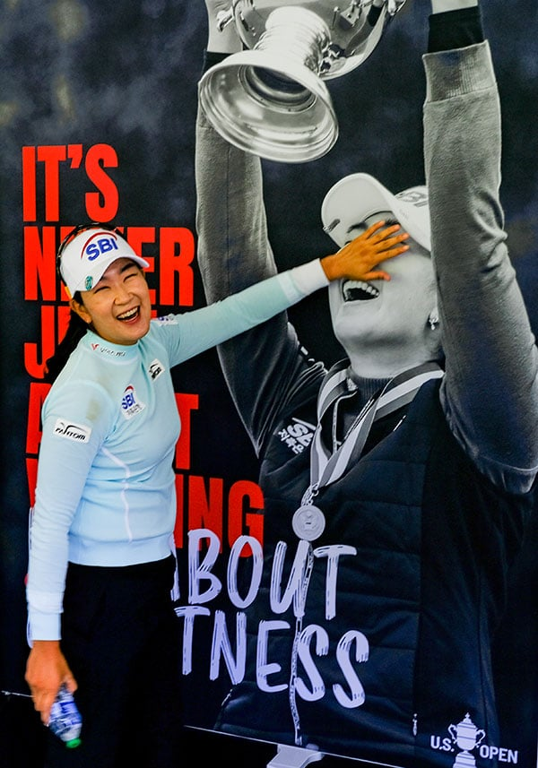A Lim Kim reacts to seeing a poster of herself during a practice round during the 2021 U.S. Women's Open at The Olympic Club in the San Francisco, Calif. on Monday, May 31, 2021. (Copyright USGA/Jeff Marsh)
