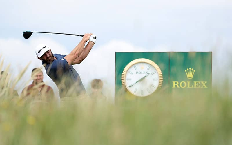 Dustin Johnson of the United States tees off during a practice round for The 149th Open at Royal St George's Golf Club on July 11, 2021 in Sandwich, England. (Photo by Warren Little/R&A/R&A via Getty Images)