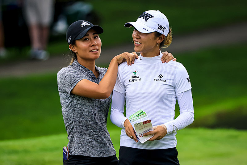 Danielle Kang (L) and Lydia Ko smile after a birdie on the fifth hole during the second round of the Dow Great Lakes Bay Invitational at Midland Country Club in Midland, Michigan. (Photo by Sam Greenwood/Getty Images)
