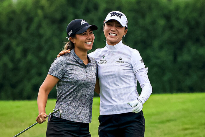 Danielle Kang (L) and Lydia Ko celebrate an eagle on the 11th hole during the second round of the Dow Great Lakes Bay Invitational at Midland Country Club in Midland, Michigan. (Photo by Sam Greenwood/Getty Images)