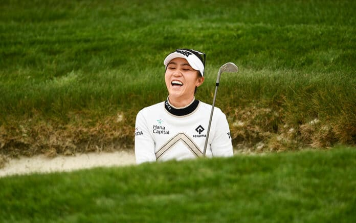 Kiwi Lydia Ko reacts to a bunker shot on the 11th hole during a practice round at the 2021 U.S. Women's Open at The Olympic Club in San Francisco. (Robert Beck/USGA)