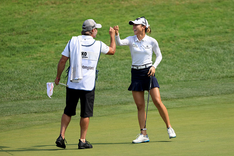Lydia Ko celebrates a birdie putt with her caddie on the 14th hole during the first round of the Dow Great Lakes Bay Invitational on July 14, 2021 in Midland, Michigan. (Photo by Sam Greenwood/Getty Images)