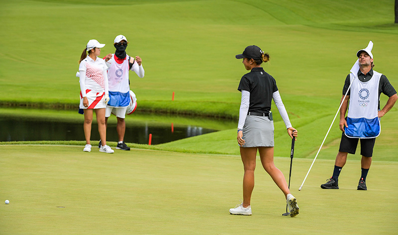 Lydia Ko and her caddy react to her missed putt on the 18th green in a playoff against Mone Inami of Japan during the final round of the Women's Individual Stroke Play event on Day 18 of the Tokyo 2020 Olympics at the Kasumigaseki Country Club on August 7, 2021 in Saitama, Japan. (Photo by Stan Badz/PGA TOUR/IGF)