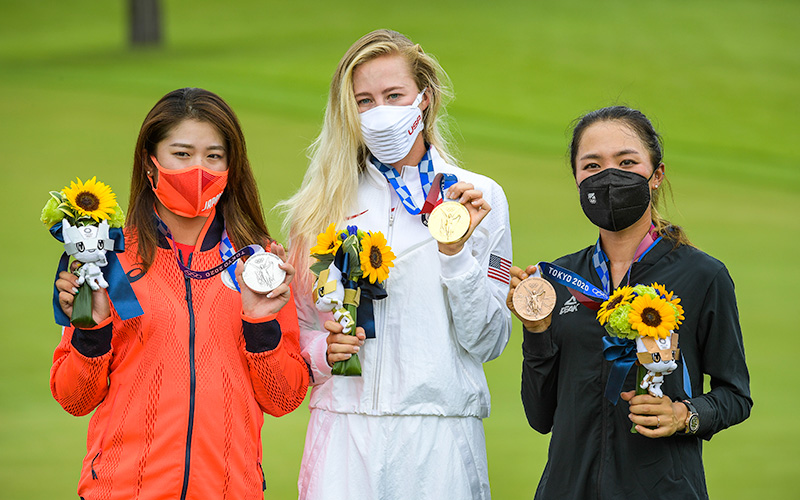 Mone Inami of Team Japan celebrates with the silver medal, Nelly Korda of Team United States celebrates with the gold medal and Lydia Ko of Team New Zealand celebrates with the bronze medal at the Victory Ceremony after the final round of the Women's Individual Stroke Play event on Day 18 of the Tokyo 2020 Olympics at the Kasumigaseki Country Club on August 7, 2021 in Saitama, Japan. (Photo by Stan Badz/PGA TOUR/IGF)